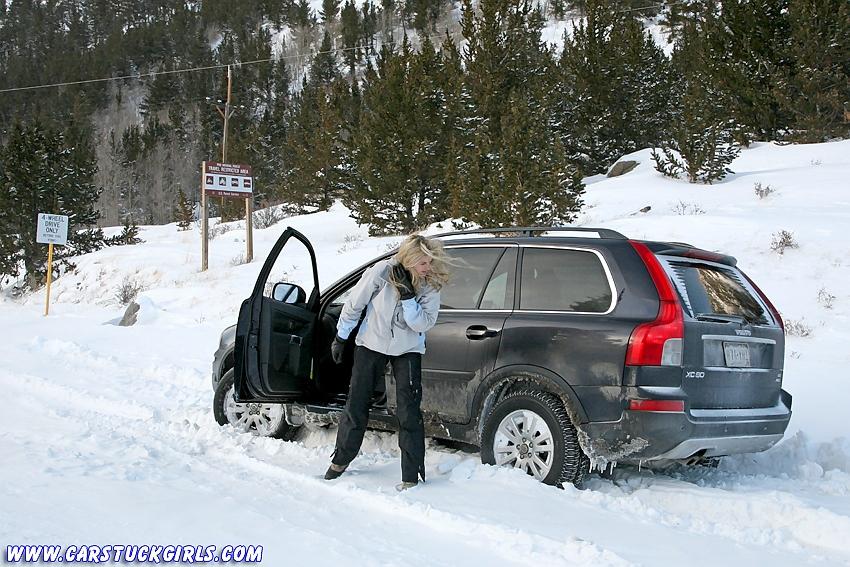 Snowboard Girl In Volvo Xc90 Stuck In Snow